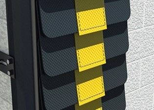 Stacked black mats with yellow stripe going down the middle
