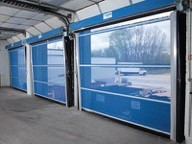 Interior of three blue doors with see-through panels